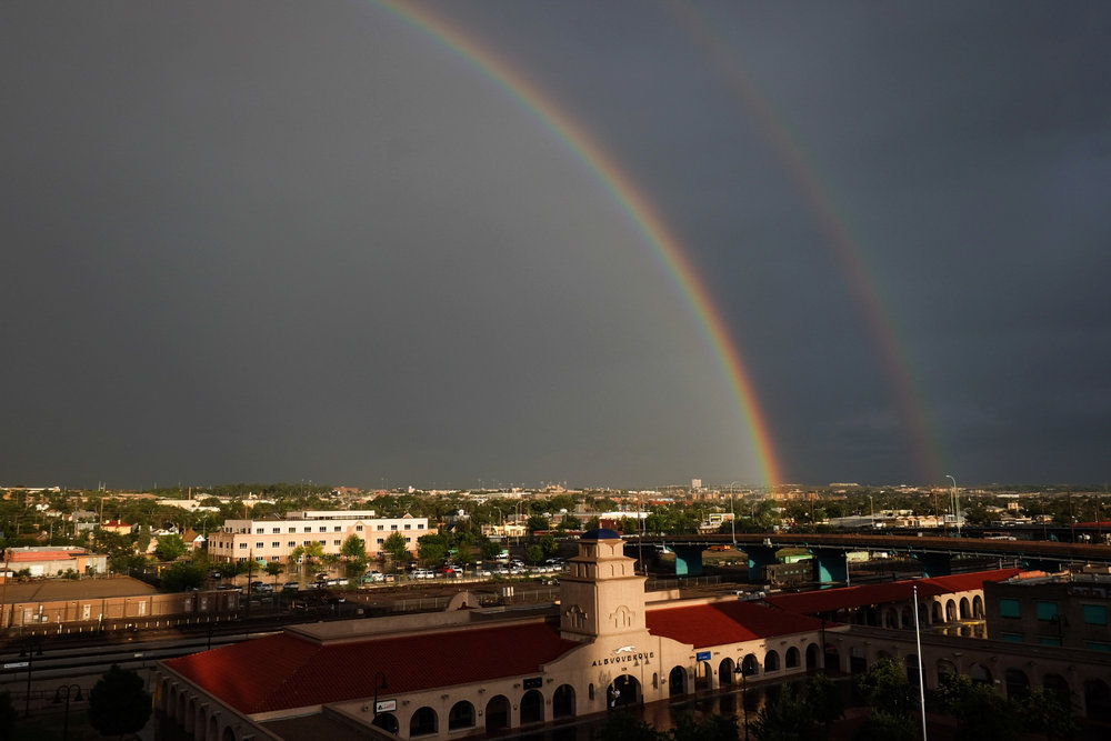 A double rainbow is seen over the city after a late afternoon rain storm rolled through the city, Thursday, July 31, 2014. (Morgan Petroski/Journal)