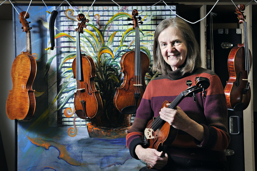 Female violin artist business portrait by Morgan Petroski Photography.