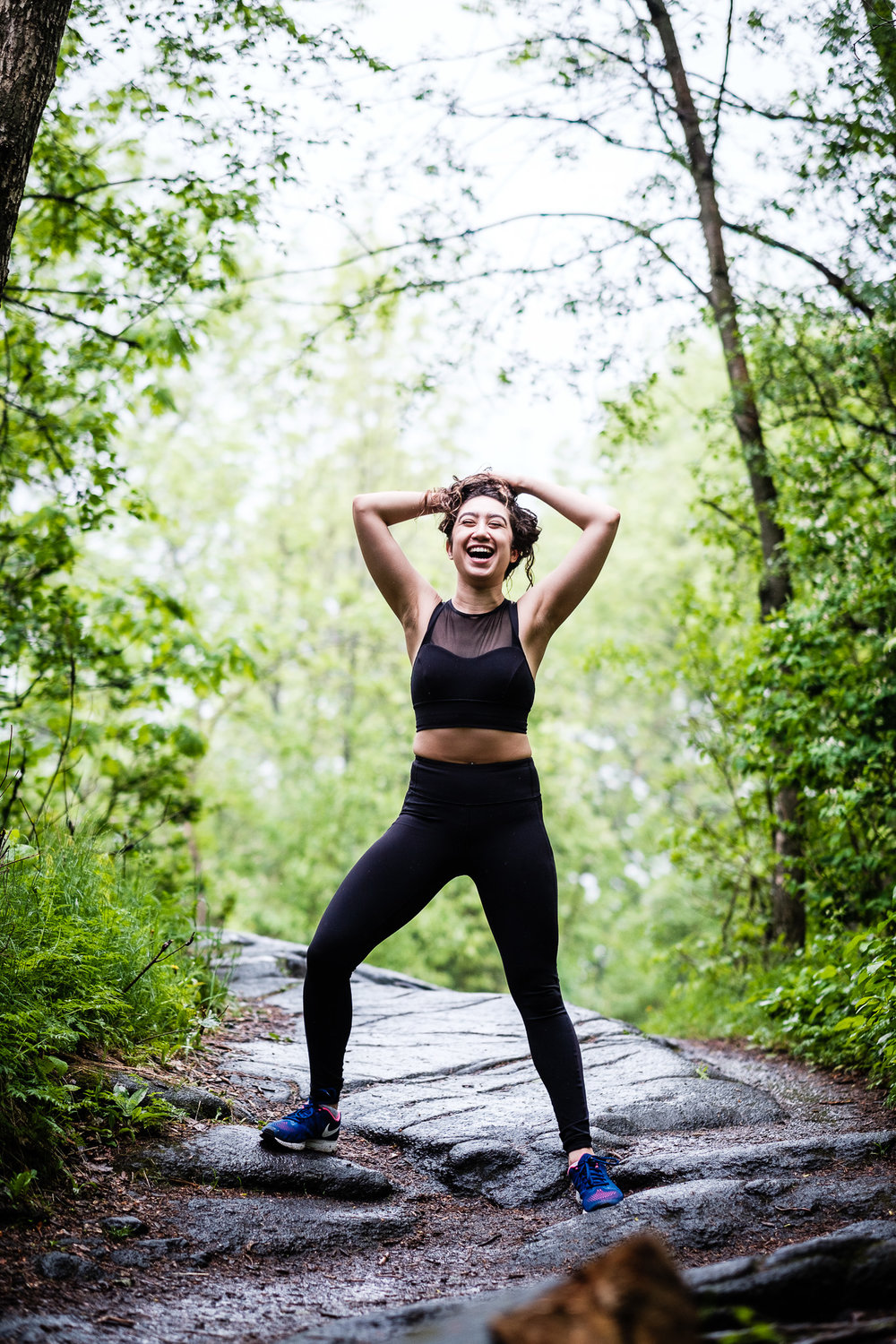 Female fitness blogger in Montreal on Mont Royal in athletic apparel taken during personal branding session.
