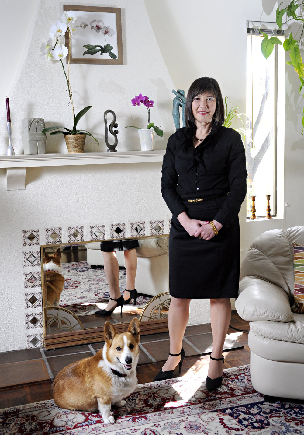 Female business owner portrait with dog in her home taken by Morgan Petroski Photography, located in Montreal.