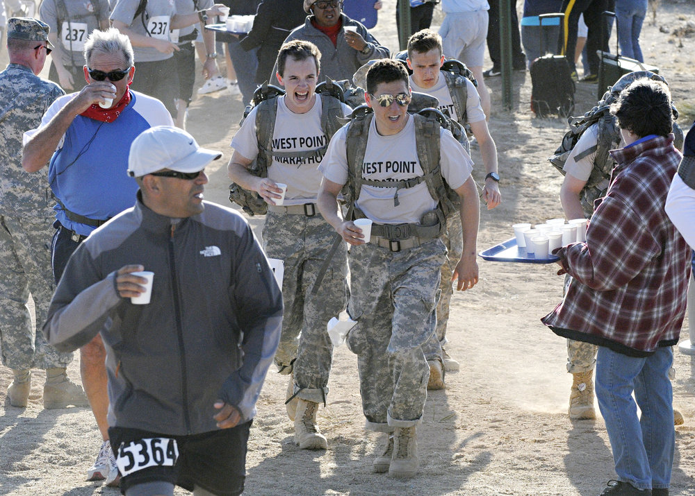 Walk participants hydrate at water point 3 during the 22nd Annual Bataan Memorial Death March at White Sands Missile Range, Sunday, March 27, 2011. (Morgan Petroski/Albuquerque Journal)