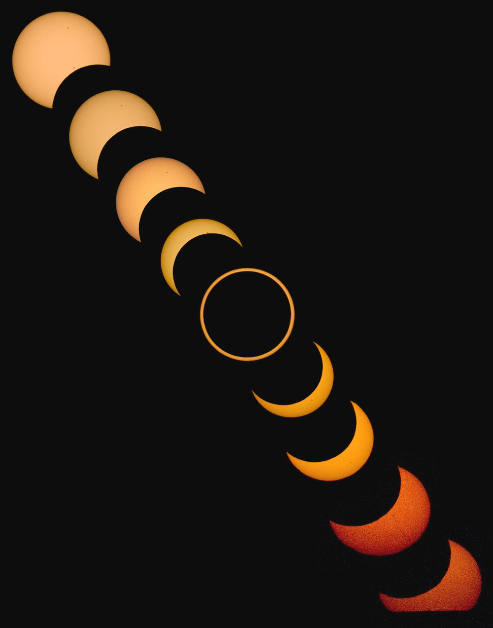 An assembled image of the annular solar eclipse as viewed from Albuquerque, NM, Sunday, May 20, 2012. At bottom right, near the end of the eclipse, the sun was setting below the horizon, which is the reason it is cut off along the bottom. (Morgan Petroski/Albuquerque Journal)