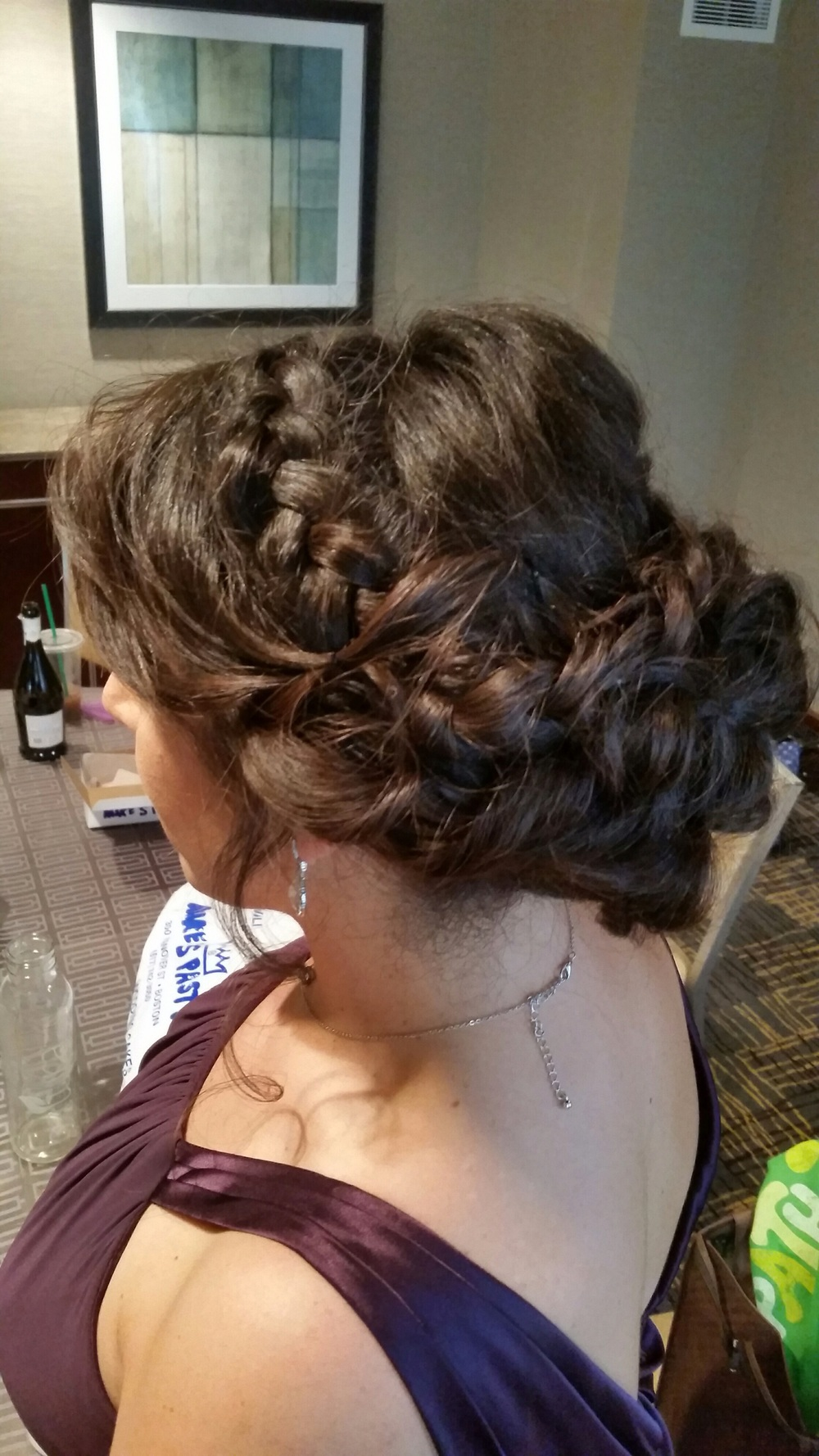 Bridesmaid with a low messy updo with a Dutch braid