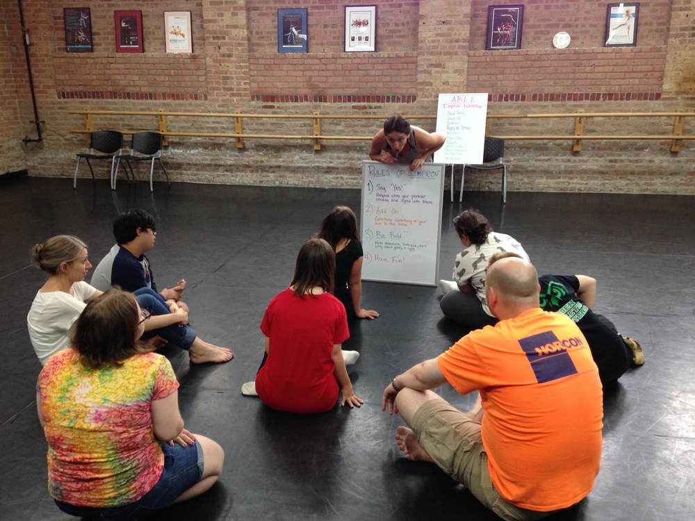 The group goes over the Rules of Improv.