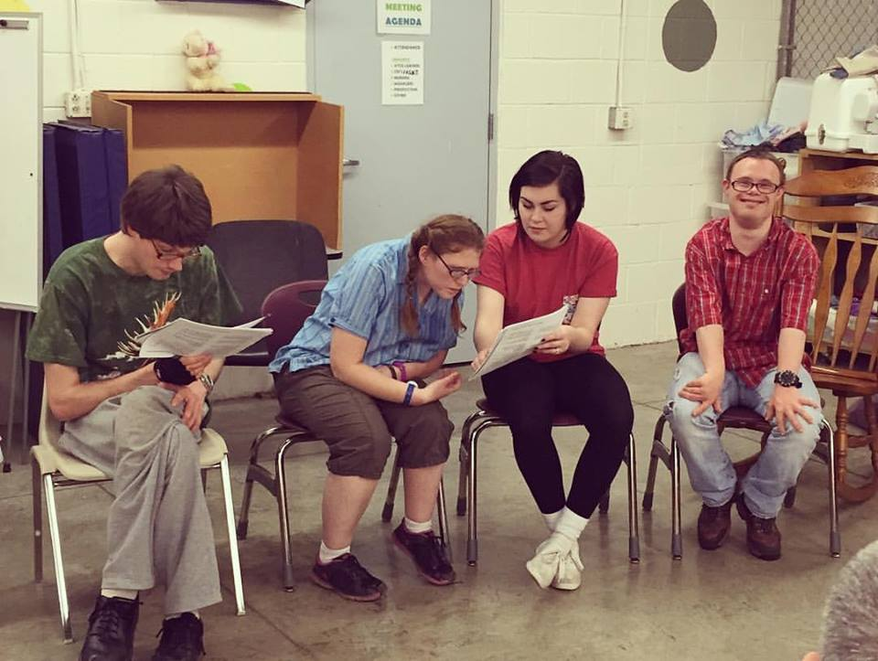 Daisy doing a staged reading with her theatre group at ATCO, a center for adults with disabilities in Athens, Ohio. She used this experience to help her during her time at ABLE.