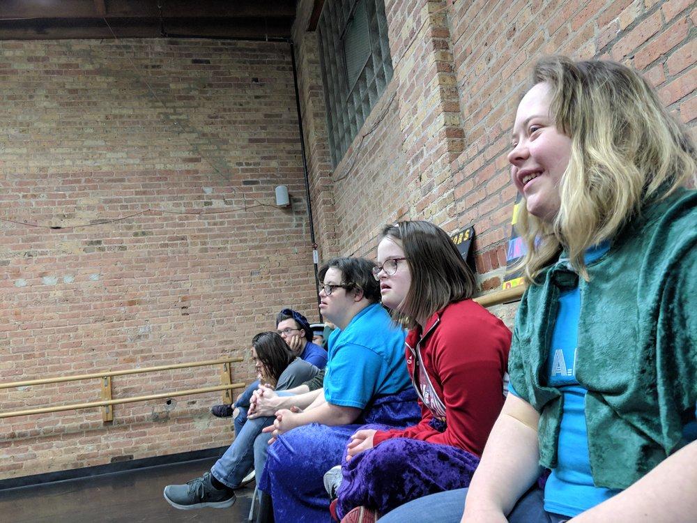 The Monday ensemble watches their classmates