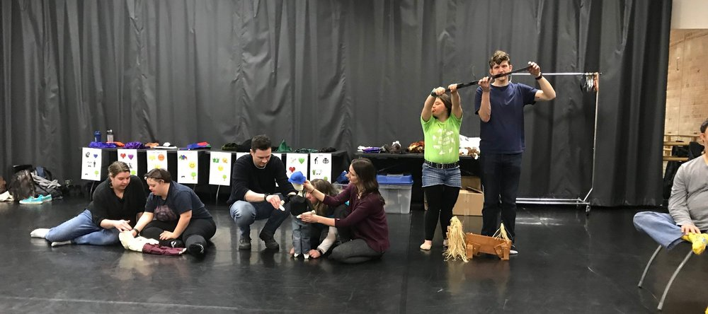 Our Monday ensemble makes a puppet tableaux with Mary and Lucy as the sleeping Oliver, Lawrence, Colleen, and Katie as the brave Orlando, and Sandia and Nate as the lion.