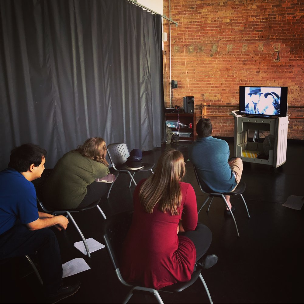 The cast watches a classic scene from Casablanca to prepare for Marty and Emily K's big scene!