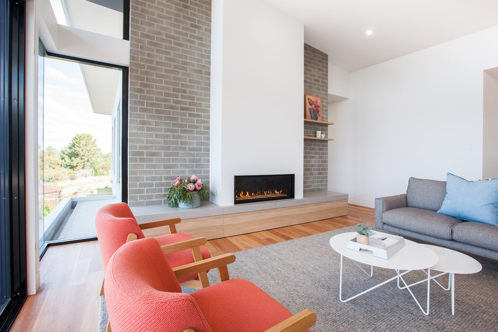 Lounge room featuring gas fireplace and bench seating with in-built drawers