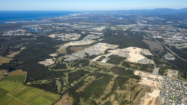 A recent aerial photograph of Pimpama and its cleared land for estates, on the western side of the M1 looking south to Surfers Paradise. Photo: skyepicsaerialphotography
