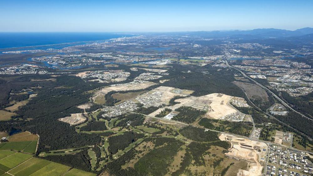An aerial shot of Pimpama showing the Coast's northern growth suburb and cleared land for residential estates on the western side of the M1 looking south to Surfers Paradise. Picture:skyepicsaerialphotography
