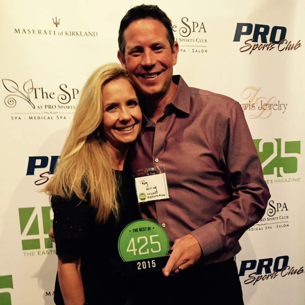 Principal Reg Willing with his Wife Samantha accepting his award for Best Builder 2015 from 425 Magazine.