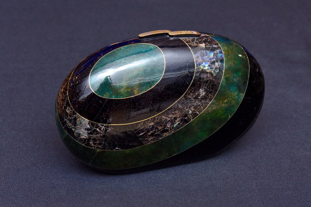 or the Liz Minaudière in black, green and rainbow shell inlay.