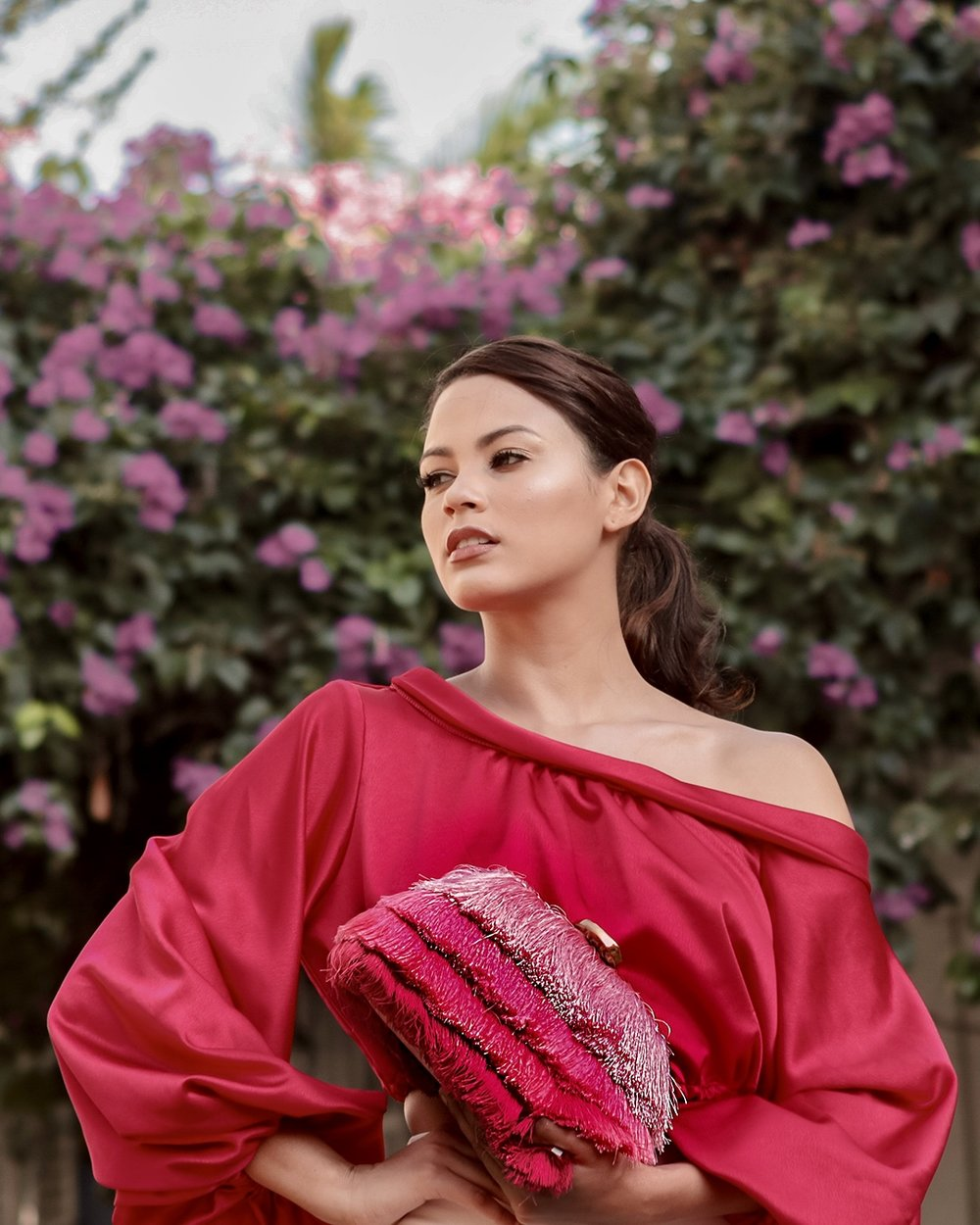 Catalina Mouthon    clutching my Amanda clutch in ombre' pink.