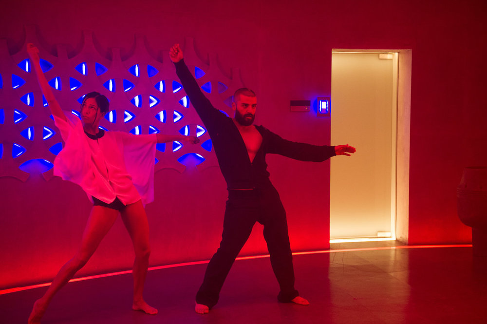 Sonoyo Mizuno and Oscar Isaac get their groove on in the mad scientist's underground layer in ex_machina.