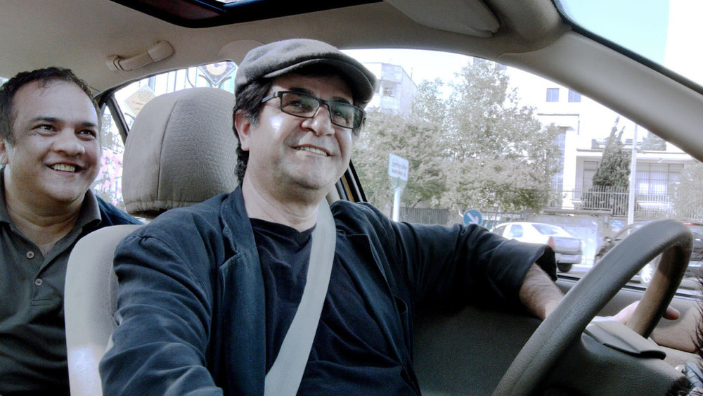 Take a ride through modern-day Tehran and the meaning of filmmaking in  Jafar Panahi's Taxi (a.k.a. Taxi Tehran –    تاکسی   ‎‎  ).
