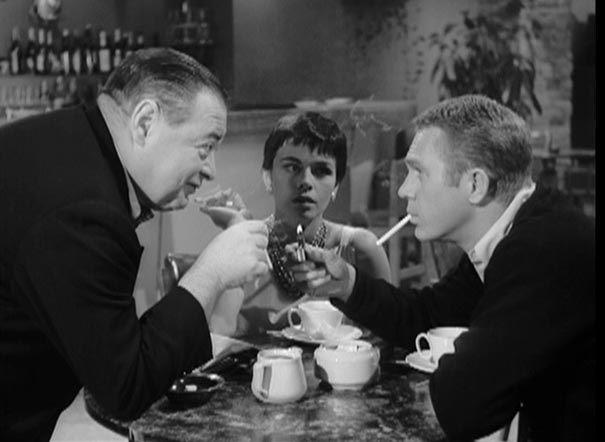 Peter Lorre, Neile Adams and Steve McQueen in  Alfred Hitchcock Presents: Man From the South  (1960).  Alfred Hitchcock Presents  was one of many twisted TV shows to bring Roald Dahl's short stories to the screen, and a total of six stories by Dahl appeared during the show's early seasons.