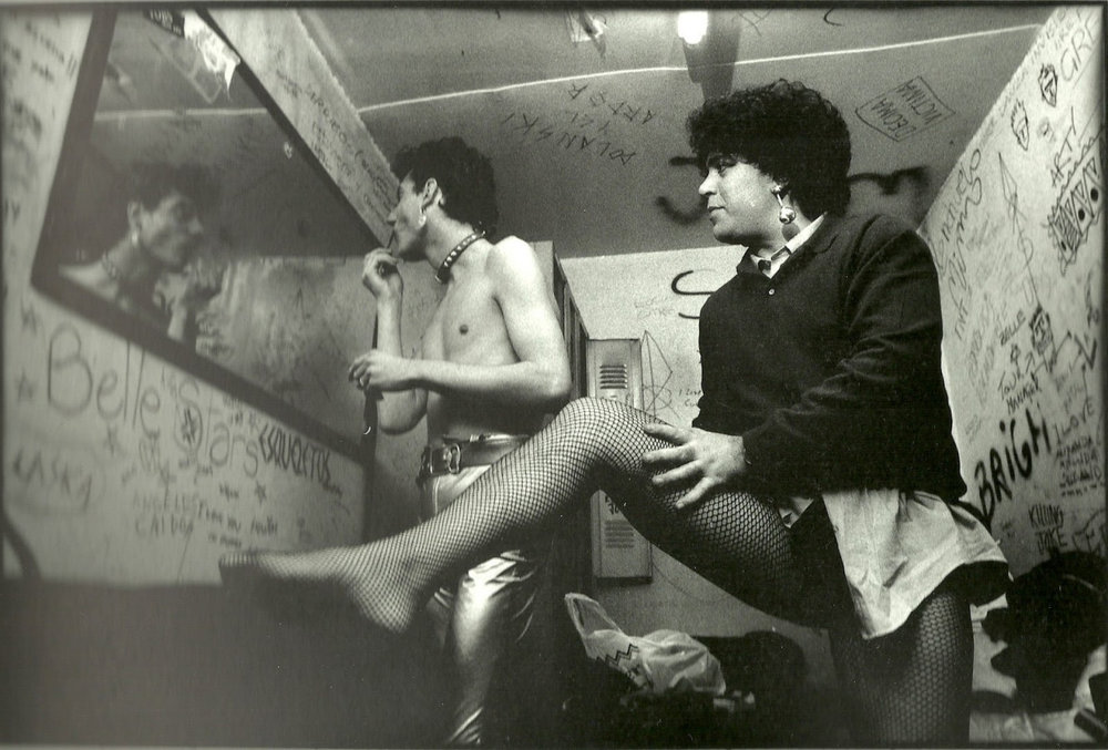 Fabio McNamara and Pedro Almodóvar prepare for a performance as the glam rock parody duo Almodóvar & McNamara in 1970s Madrid. It was at this time that Almodóvar was one of the many active figures at the heart of the New Madrid Scene (La Nueva Movida Madrileña), which had a heavy influence on the politically and sexually liberated youth culture of post-Francoist Spain.