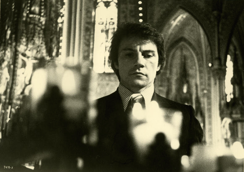 Harvey Keitel plays squeaky-clean, devout Catholic gangster Charlie in Mean Streets.