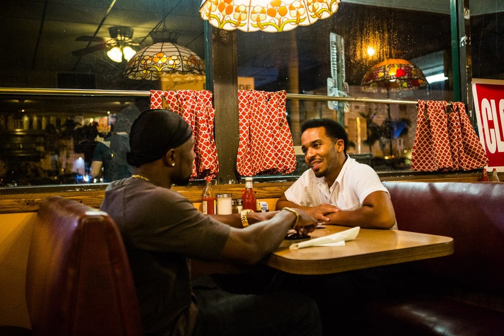 Trevante Rhodes and André Holland play characters reunited after ten years apart in the touching denouement of Moonlight.