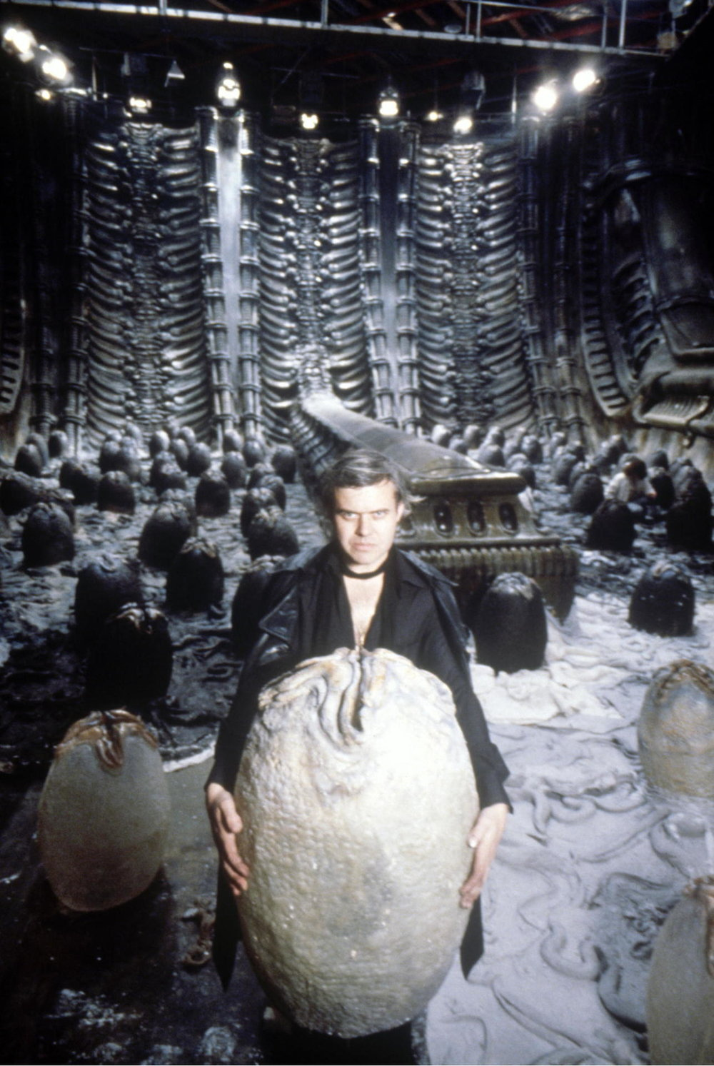 HR Giger with a face-hugger egg on the set of  Alien .