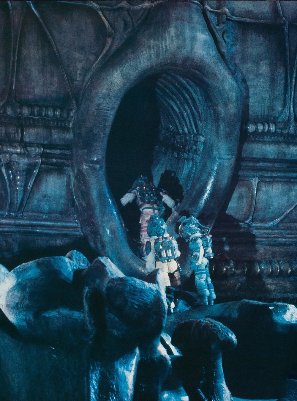 The crew of the Nostromo enter the suggestive organic openings of the derelict alien spacecraft.