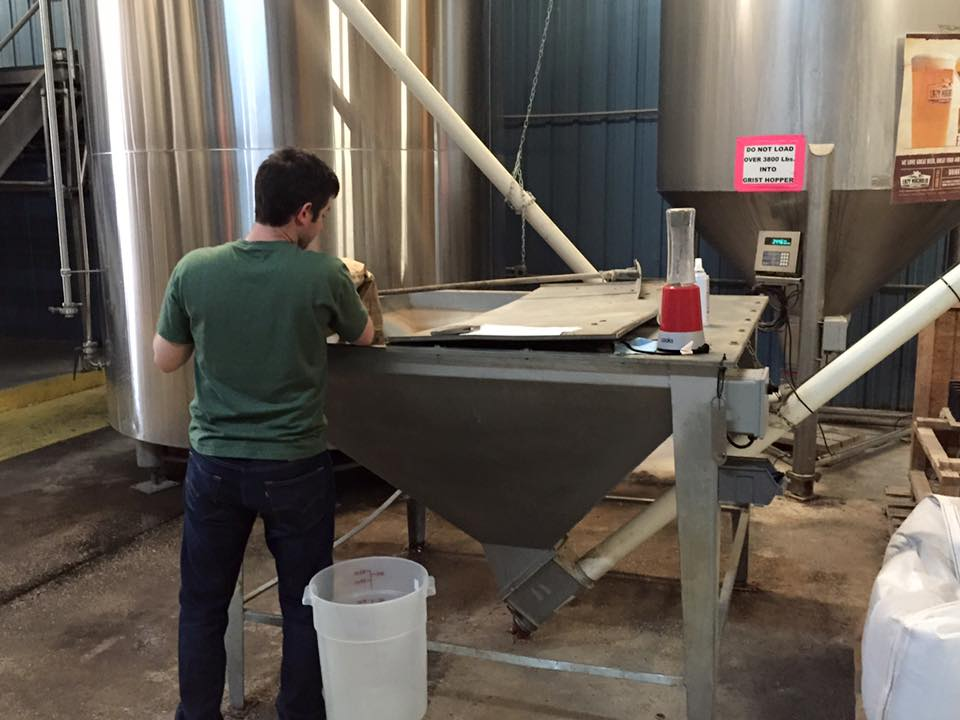 Trey milling grain for the first batch of Dry County IPA 2015