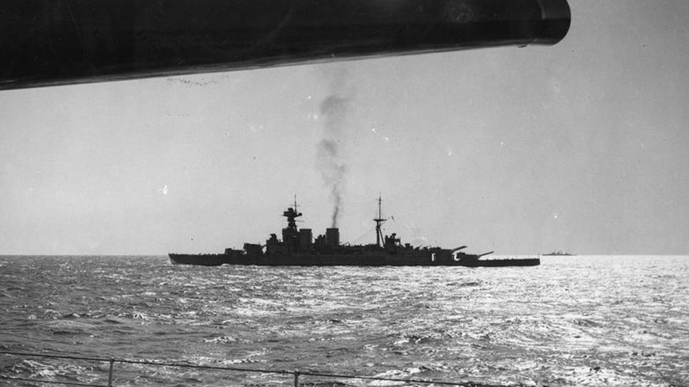 "Imperial War Museum Photo: HU 76078 (Part of the Ministry of Information Second World War Press Agency Print Collection). The Royal Navy battleship HMS Hood in the middle distance viewed beneath the silhouetted 15"" gun of HMS Renown. Photo taken by Topical press photographer."
