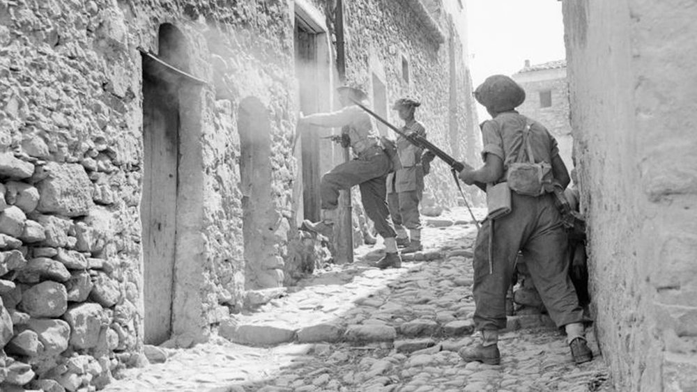 Imperial War Museum Photo: NA 5388 (Part of the War Office Second World War Official Collection). Men of the 6th Battalion, Royal Inniskilling Fusiliers, 38th Irish Brigade, searching houses during mopping up operations in Centuripe, Sicily in August 1943. Photo taken by Captain Richard Felix Gade - No 2 Army Film and Photographic Unit.