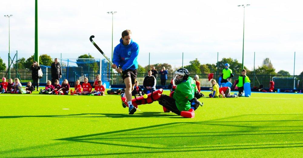 Great Britain international Dave Goodfield demonstrates goalscoring against 2 x World Goalkeeper of the Year David Harte at an EVO Hockey event