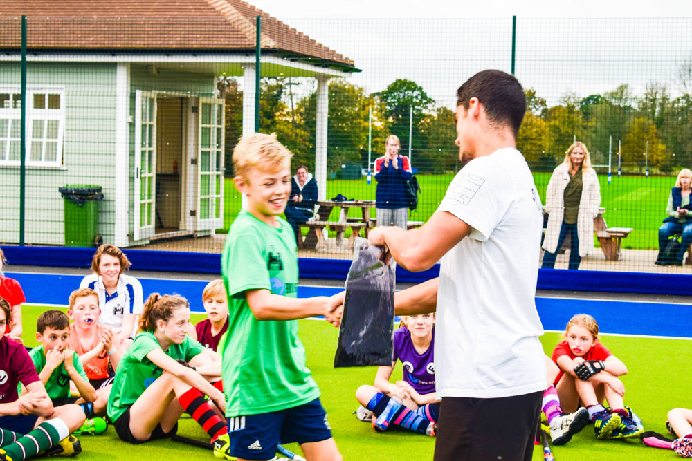 Luke receiving his freestyling prize from legendary freestyle skillers Self-Pass at EVO Hockey's October 2017 camp