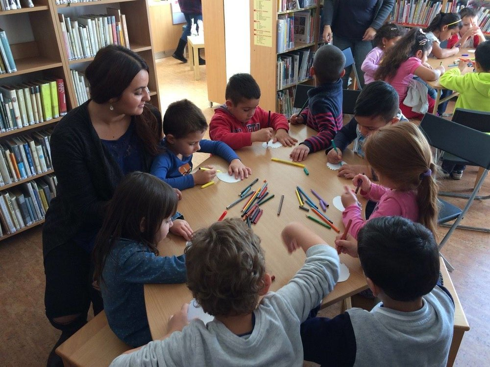 Roma children with their teacher in a kindergarten in Ostrava. Photo credit: Open Society Fund Prague