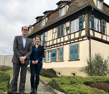 Kevin Steeves, EIN Director, and Agnès Ciccarone, EIN Finance and Events     Officer, in front of the René Cassin Foundation, home of the EIN Secretariat