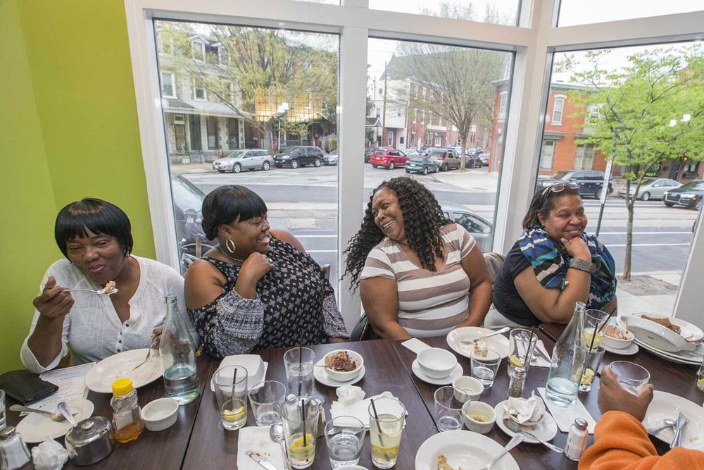 EAT customers enjoying a Pay What You Can meal
