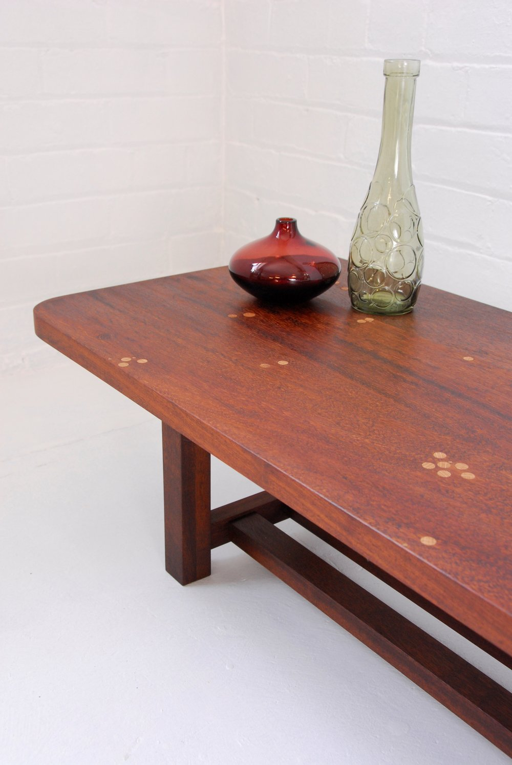 A coffee table with local history - Whilst rummaging through a local reclamation yard we discovered some beautiful iroko timber planks. In a previous life they were the banisters from the iconic Park Hill flats in Sheffield. We repurposed the timber into a table. The bolts holes were filled with oak dowelling to create an intriguing surface design that tells a story.Height: 30cm Width: 100cm Depth: 44cmFor sale: £700