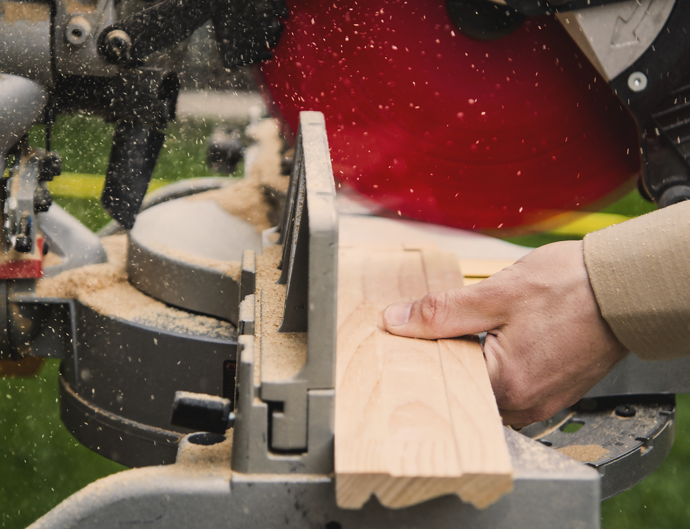 carpenter sawing boards