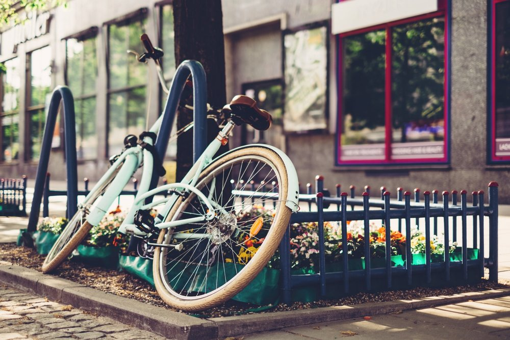 vintage_bicycle_leaning_against_a_bike_rack_3.jpg