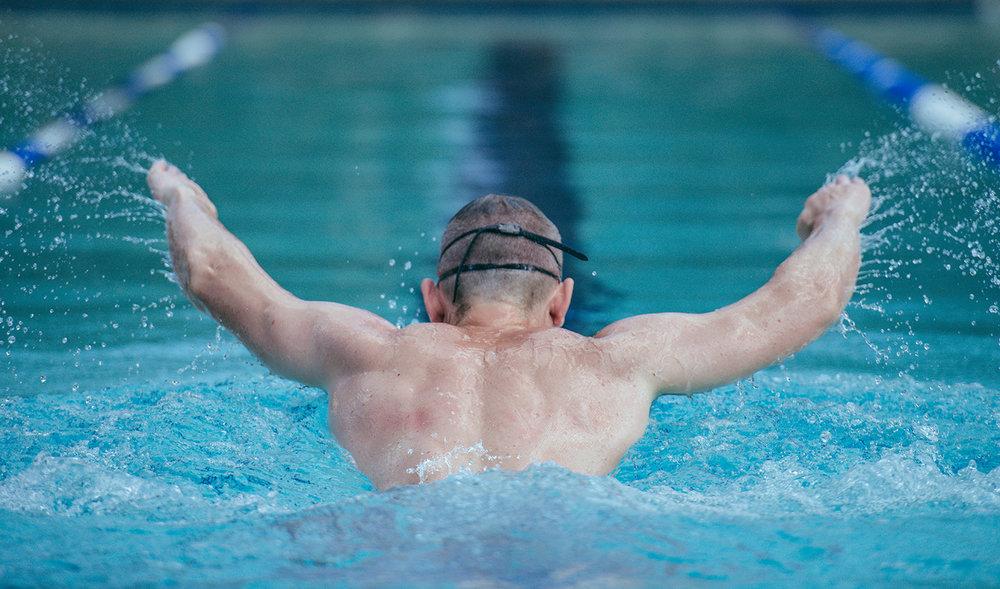Man Swimming Freestyle In Swimming Pool.jpg