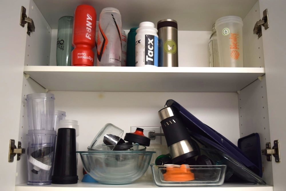 Example. It's a disaster. Why do we have so many water bottles, you ask? Because the hubs is a rock star cyclist.