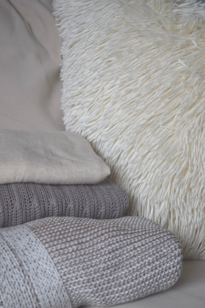 All totally neutral beige, but the difference in textures create interest and depth