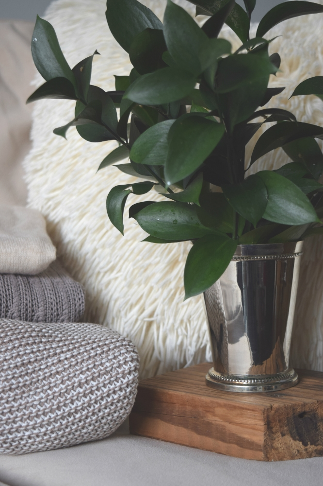 Here, a shiny silver tumbler doubles as a small vase for greenery. It adds just the right amount of sparkle!