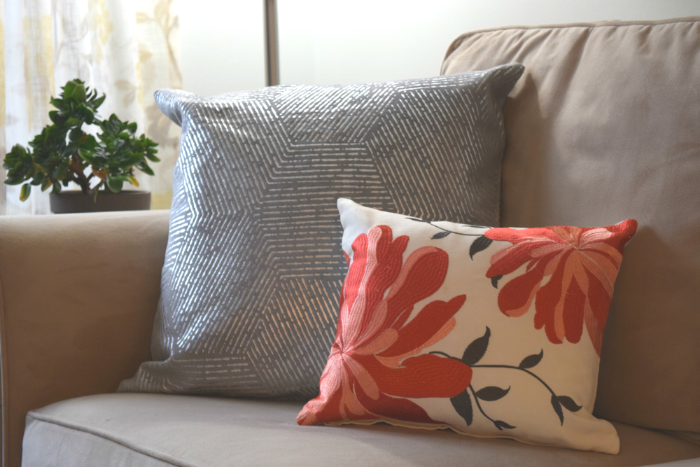 I snagged both of these pillows for a total of $60 from Target! And you can, too! Scoop up the Floral Indoor/Outdoor Decorative Pillow in coral here and the Rizzy Home Cotton Decorative Pillow in Gray here.