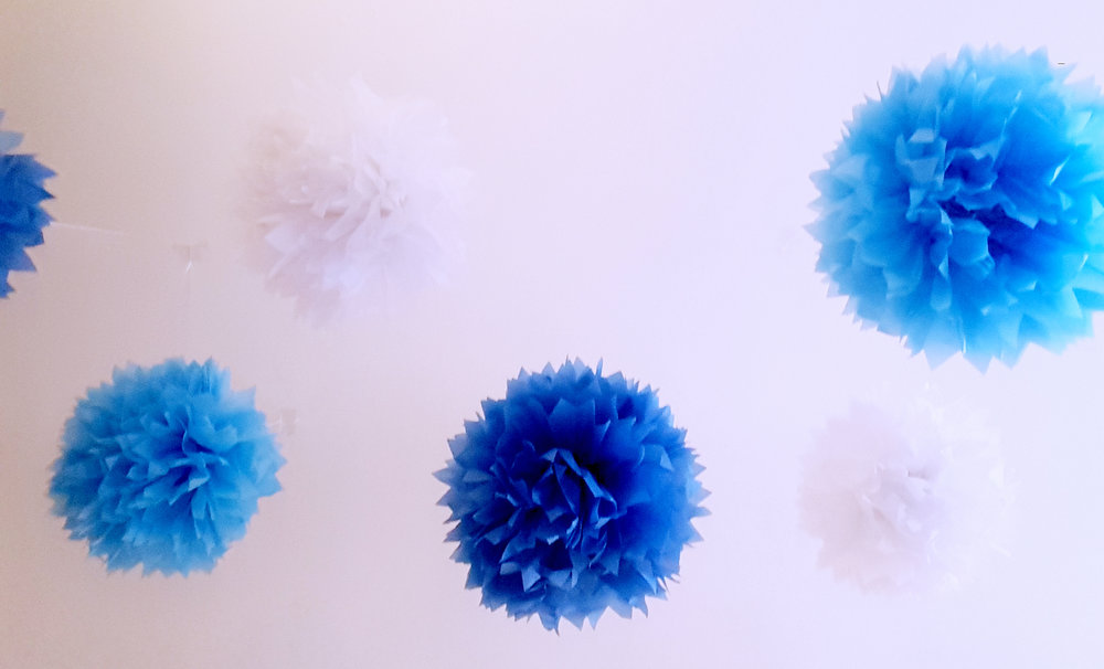 Our friends threw us a going away party! The friend who hosted went all out with the decor. She's a fabulous decorator and I love these poms she hung from the ceiling.