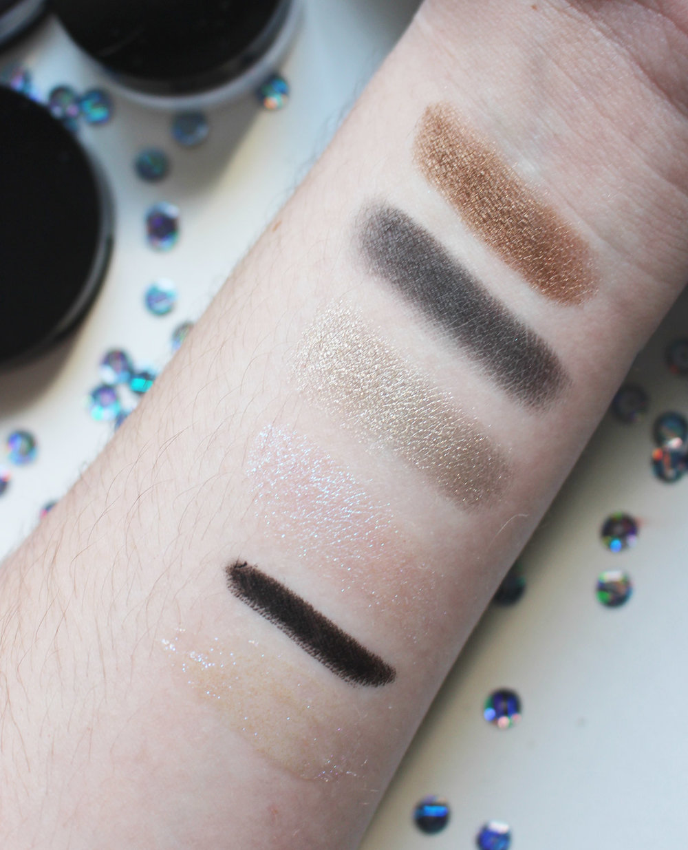 Ultrasuede Brown, Dark Matter, Mercury, Astral White, Kohl Liner, Eye Gloss