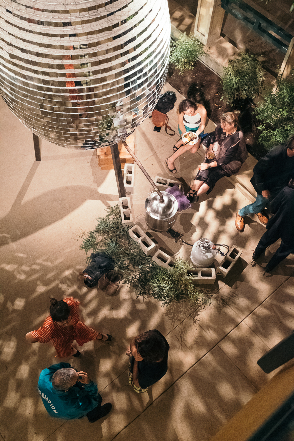 Our guest basking in the light of Michael Parker's Steam Egg at M&A's Fête at Fifteen, which celebrated fifteen years of experimental architecture.