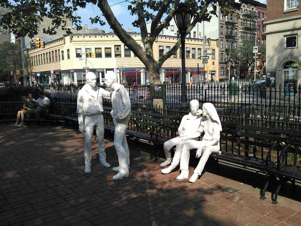 "Groupon Approved: George Segal's sculpture ""Four Figures"" in front of the Parks dept. interpretive sign with a Fred W. McDarrah photo, in Christopher Park. The park is directly across the street from Stonewall."