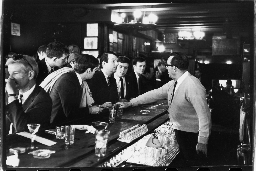 After pouring their drinks, a bartender at Julius's Bar, 159 West 10th St., refuses to serve John Timmins, Dick Leitsch, Craig Rodwell and Randy Wicker, members of the Mattachine Society, an early American gay rights group, who were protesting New York liquor laws that punished bars for serving gay customers, April 21, 1966. The iconic photo is one of many by Fred W. McDarrah in the collection of the National Portrait Gallery:  (http://npg.si.edu/object/npg_NPG.2004.152).