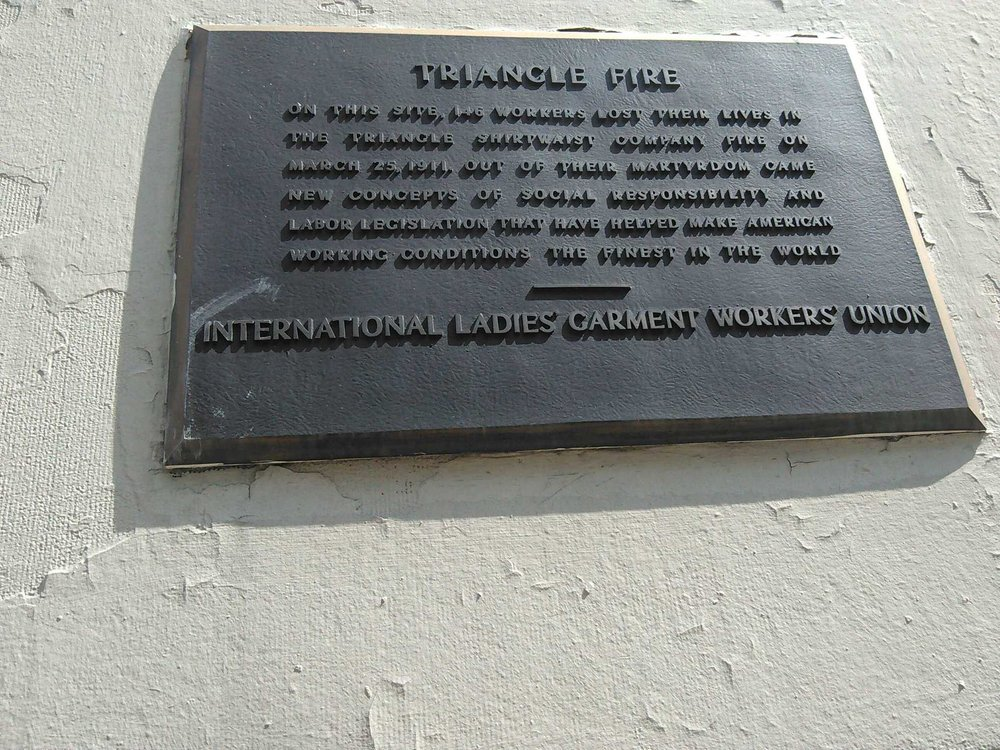 One of the three plaques on the building.