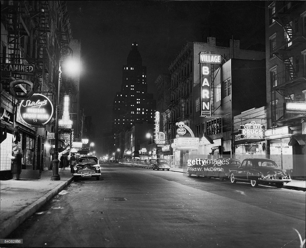 8th St. at night? Cool. Great reviews? Also cool. (Photo by Fred W. McDarrah)