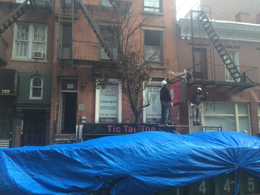 Sign removal, 161 West 4th St.